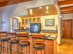 Pull up a stool to the 4-person breakfast bar!