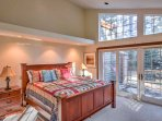 Bright windows flood the master bedroom with natural light.