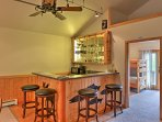Pull up a stool! Serve your buddies their favorite drinks from the 4-person bar.