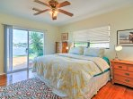 The master bedroom boasts a king bed and sliding doors to access the backyard.