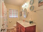 Rinse off in a hot shower in this full bathroom.
