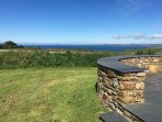 Slate terrace within the grassy garden of The Old Granary with an incredible sea view
