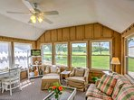 The welcoming sun room boasts comfortable furnishings, a flat-screen TV and natural light flooding from wall-to-wall...