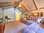 Venture upstairs to the family game room, equipped with a TV, arcade game & sofa