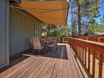 Enjoy the fresh breeze as you sit outside on the patio, shaded by the awning.