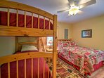 The third bedroom offers a twin-over-twin bunk bed and full-sized bed.