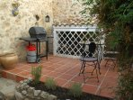 Court yard behind the kitchen. Nice and shady in the summer. Gas BBQ available