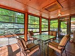 Relax with a good book or enjoy a family dinner in this screened-in sunroom.