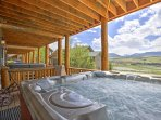 Relax and soak in a private hot tub with incredible background views at this Fraser vacation rental condo!