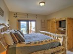 The master bedroom boasts a king-sized bed, flat-screen TV and patio access.