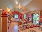 Inside, the home features bright red walls and antique decorations throughout.