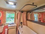 The home features 1 bathroom with a claw-foot tub.