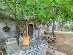 You'll love sitting on the patio under the canopy of trees as you sip your morning coffee.
