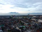 Bandung city view with mountains backdrop on a clear day