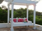 Enjoy the easterly breezes under the pergola on the daybed