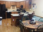 Updated kitchen with dining area for 6, with additional counter seating.