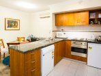 A fully-equipped kitchen with dishwasher, microwave oven and more