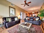 Spacious living room has plenty of comfy seating.