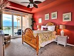 Master bedroom has a queen size bed.