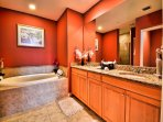 Garden tub with double sinks in the master bathroom.