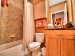 Guest room bathroom has shower / tub combination.