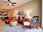 Living room has plenty of comfy seating.
