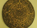 Aztec calendar in the living room. Homemade and at least 40 years old.
