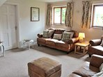 Cosy living room, with lovely leather sofas, seating 6