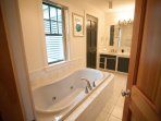 Master Bathroom with jetted tub, shower, dual vanity, toilet