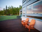 Deck with Adirondack Chairs.
