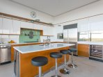 The chef's kitchen is fully equipped and seats four.
