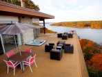 Breathtaking views from the glass-railed infinity deck with year-round hot tub and BBQ grill.