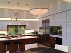 Kitchen lighting provides task focus with an ambient mood.
