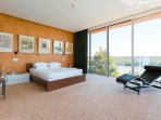 The master bedroom is a calm oasis of simple design integrating the house's magnificent setting.