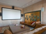 The media room has a 10' screen and theatre surround sound. It's secluded off the living area.