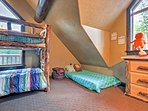 The kid's room has a twin-over-twin bunk bed and twin cot.
