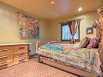 The Wood Room features a queen-sized bed and queen-sized pullout mattress.