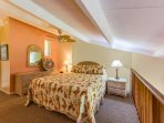 Enjoy the upstairs king size bed while listening to the ocean waves and tropical breezes.