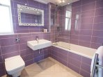 Stunning bespoke Italian designer bathroom with luxurious underfloor heating & White Company towel