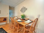 Four guests can eat at the dining table.