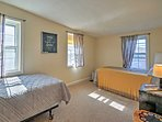 The twin beds in the second bedroom can both accommodate a guest.