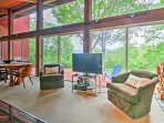 When you step into this splendid home, you' will feel like you are still outside with floor- to- ceiling windows...