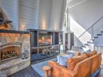 Watch your favorite shows on the flat-screen cable TV next to the gas fireplace.