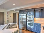 Whip up tasty meals using the kitchen's stainless steel appliances.