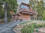 This recently updated A-frame home offers an expansive deck with patio furniture.