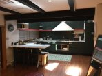 Modern kitchen with both cookware and tableware.