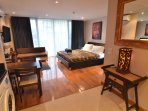 Large living area, tinted windows black out curtains and fully screened sliding glass doors