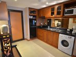 New teak kitchen, fully equipped with washing machine, hot and cold water taps double sink.
