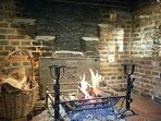 The inglenook fireplace in the kitchen with the fireback dating 1632