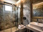 All bathrooms are spacious and have a shower cabin with hydro massage columns!
